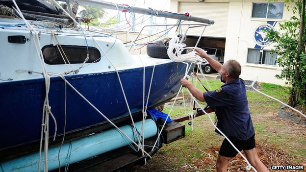 A volunteer coastguard member helps tie down a boat before Tropical Cyclone Ita makes landfall later in Port Douglas, Australia, 11 April 2014