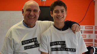 John Still in a 'control the controllables' T-shirt