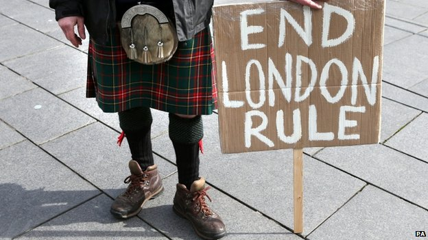 Man with end London rule banner