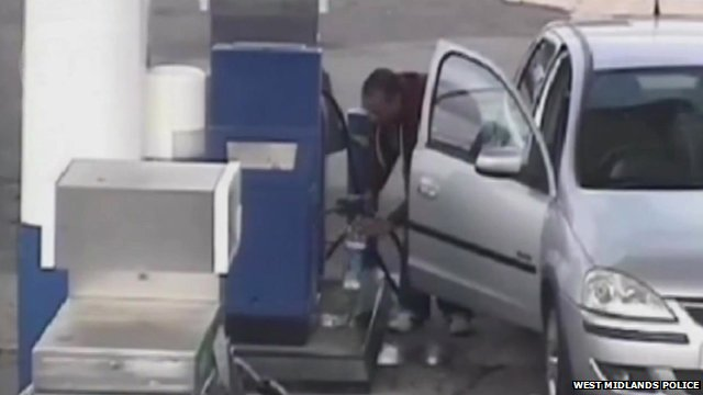 A still from CCTV footage shows Jasvir Ram Ginday filling up a water bottle with petrol in Walsall