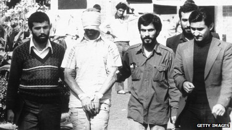 A blindfolded American hostage is paraded by his captors in the compound of the US Embassy Tehran, Iran