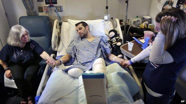 Marc Fucarile (centre) and Jen Regan (right) in a Boston, Massachusetts, hospital on 9 May 2013