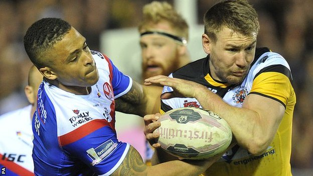 St Helens' Jordan Turner and Castleford's double try scorer Michael Shenton tussle for possession