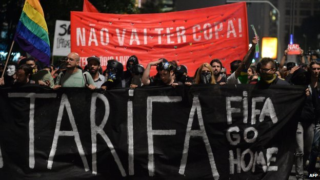 Demonstrators march to protest against the upcoming Brazil 2014 FIFA World Cup, in Sao Paulo, Brazil, on on 27 March 2014.
