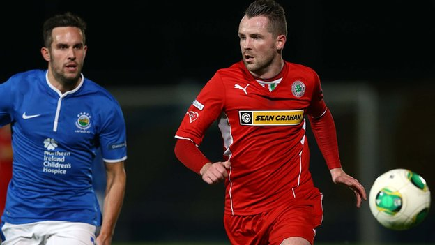 Action from the County Antrim Shield semi-final between Linfield and Cliftonville