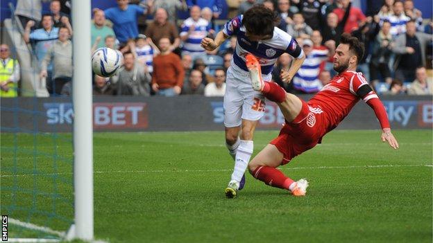 QPR midfielder Yossi Benayoun (left) heads his side ahead against Nottingham Forest