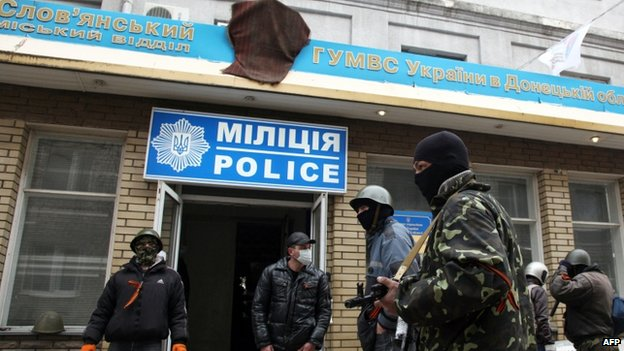Armed activists guard Sloviansk police station after it was seized by gunmen 12/04/2014