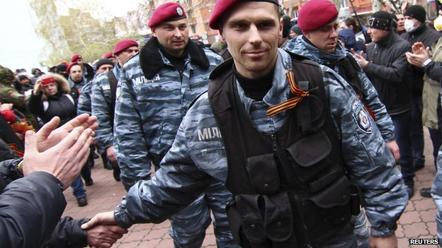 Members of the disbanded Ukrainian riot police unit Berkut arrive to support pro-Russian protesters in Donetsk April 12