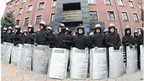 Policemen guard the prosecutor's office in Donetsk on 12 April.