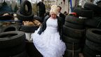 A bride and groom visit the pro-Russia rally outside the regional government building in Donetsk on 11 April.