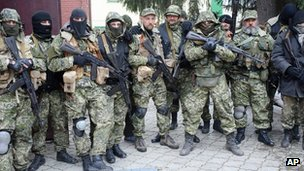 Pro-Russian gunmen pose for a photo after they seized the police station in Sloviansk