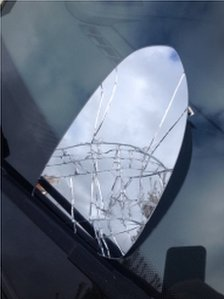 A cracked wing mirror on one of the cars that was damaged in north Belfast