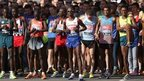 Mo Farah lines up for the start of the men's elite race