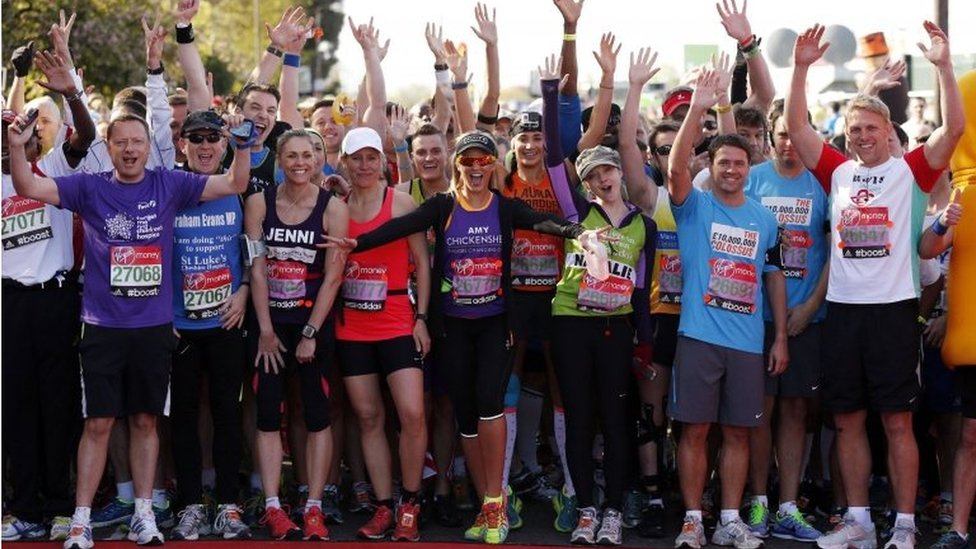 Celebrity runners gather at the start before the Virgin Money London Marathon