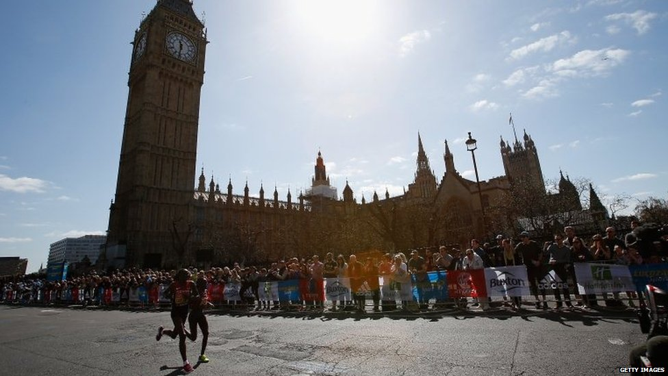 Eventual winner Edna Kiplagat and her namesake Florence Kiplagat, both from Kenya, run past the House of Parliament.
