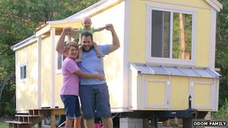 Andrew Odom, shown with his wife, Crystal, and daughter, in front of their tiny house
