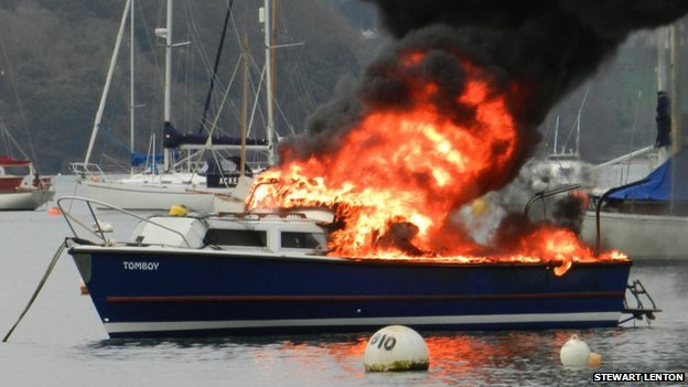 Tomboy on fire in Mylor harbour. Pic: Stewart Lenton
