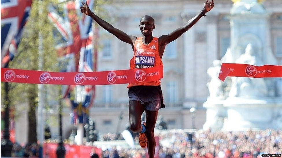 Wilson Kipsang of Kenya sprints down the Mall before crossing the finish line to win the men's elite London Marathon