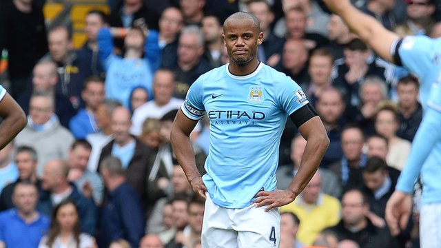 Manchester City's Vincent Kompany looks dejected after his error gifts Liverpool their winning goal