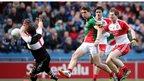 Derry goalkeeper Thomas Mallon saves a goalbound shot from Lee Keegan