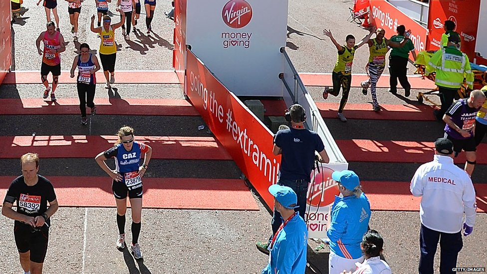 Runners cross the finish line