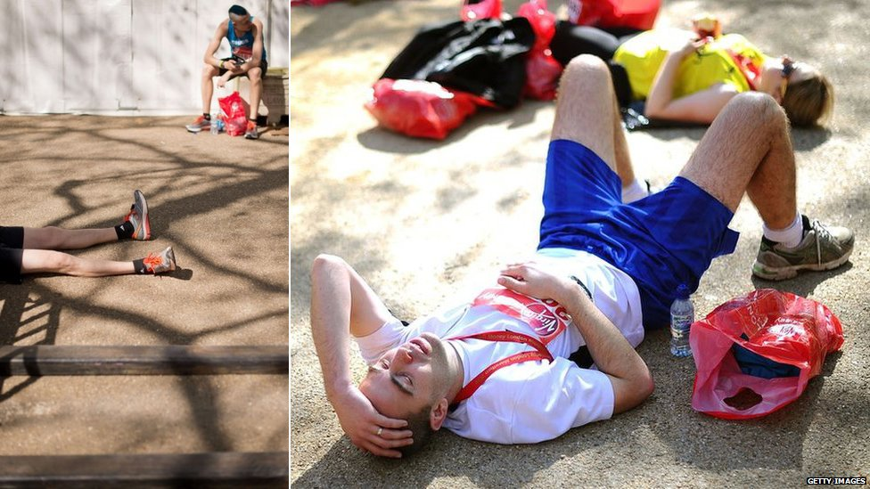 Runners rest after finishing the London Marathon