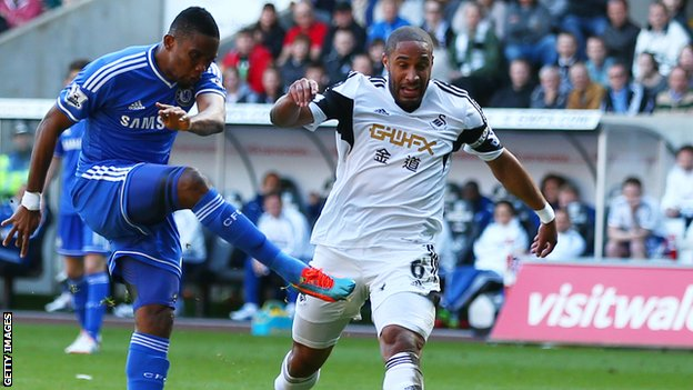 Chelsea's Samuel Eto'o and Swansea City's Ashley Williams