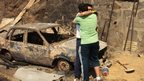 Members of a family comfort each other amid the ruins of what it was their home in Valparaiso, on April 13, 2014.
