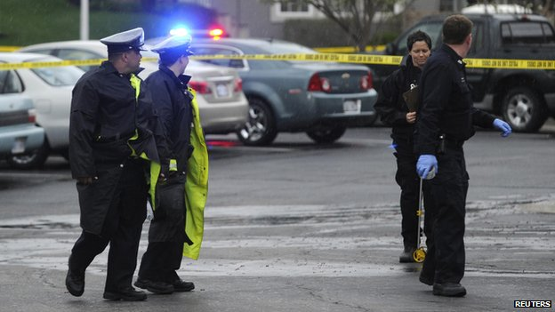 Authorities investigate the scene of a shooting at Village Shalom, an assisted living center in Overland Park, Kansas April 13