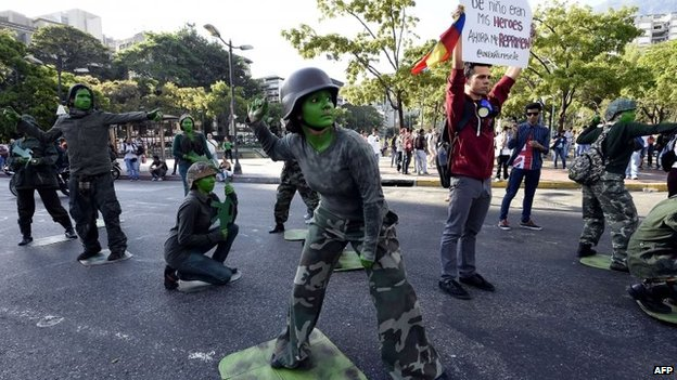 Students make a performance to protest against military repression, on April 12, 2014.