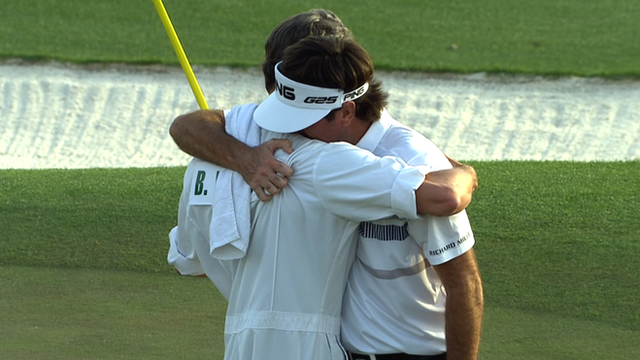 Bubba Watson hugs his caddie as he wins the 2014 Masters