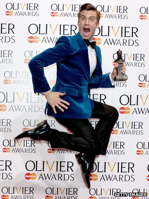 """Gavin Creel, winner of the Best Actor in a Musical Award for """"The Book Of Mormon"""" poses in the press room at"""