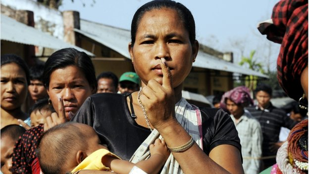 An Indian tribal woman displays her finger marked with indelible ink after casting her ballot at a polling station in Uttamjoypara, around 210 kms from Agartala, the capital of the northeastern state of Tripura on April 12, 2014.