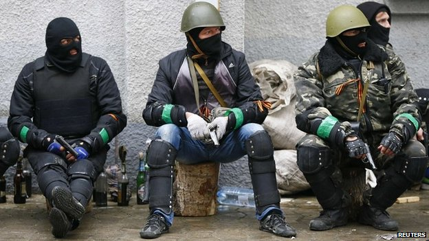 Pro-Russian gunmen outside the police headquarters in Slaviansk - 13 April 2014