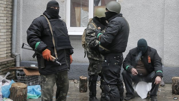 Pro-Russian gunmen holding police station in Sloviansk, 13 Apr 14