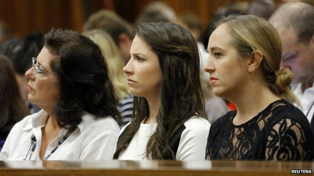 Olympic and Paralympic track star Oscar Pistorius' sister Aimee (C) sits amongst relatives during cross examination of the athlete in his ongoing murder trial in Pretoria, on 14 April 2014