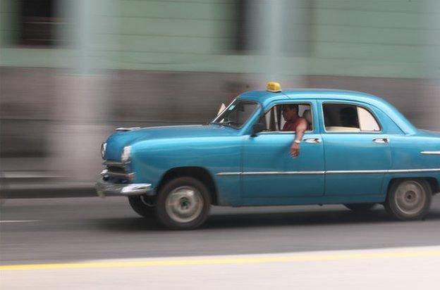 A blue taxi