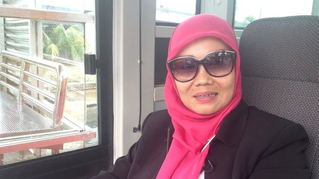 Dahlia, 40, drives the TransJakarta busway, Jakarta's bus system