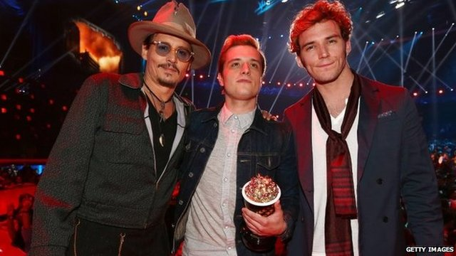 Johnny Depp poses with Josh Hutcherson and Sam Claflin