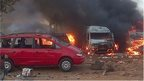 Vehicles burn after an attack in Abuja on April 14, 2014.