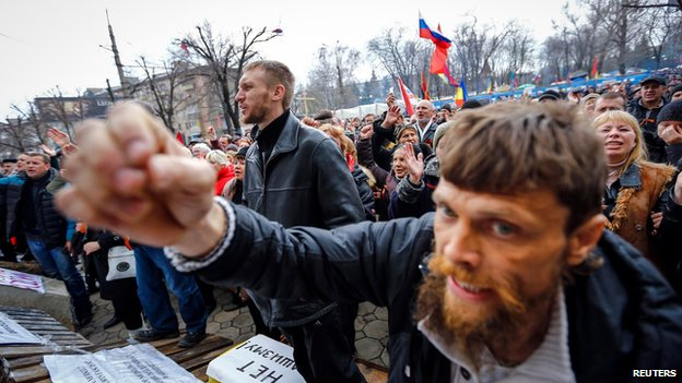 Pro-Russian protesters attend a rally in front of the seized office of the state security service in Luhansk, eastern Ukraine on 14 April 2014