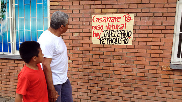 "Sign reading ""Casanare: natural paradise, now petroleum hell"" in Casanare"