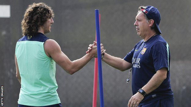 Barcelona's Carles Puyol and Gerardo Martino