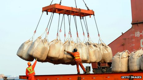 Workers unload goods from a ship at  Lianyungang, China, in Feb 2014