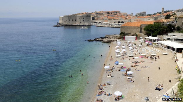 Tourists enjoy the summer on the main beach of Croatia's central Adriatic resort of Dubrovnik on in June 2009.