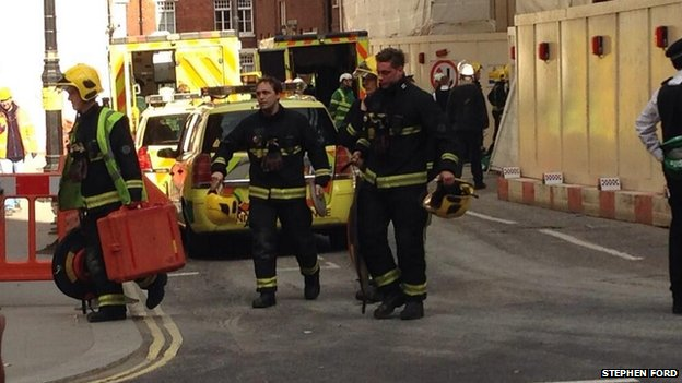 Emergency workers attend the scene of where a construction worker died