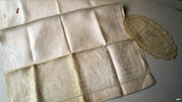 This image provided by French auction House Vermot de Pas shows a napkin bearing Adolf Hitler's initials on 14 April 2014
