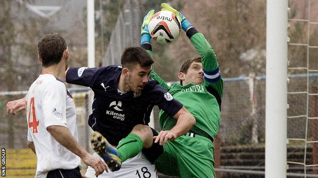 Falkirk keeper Michael McGovern in action against Dundee