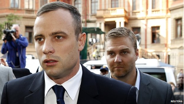 Oscar Pistorius (left) arrives ahead of his trial at North Gauteng High Court in Pretoria, 15 April 2014