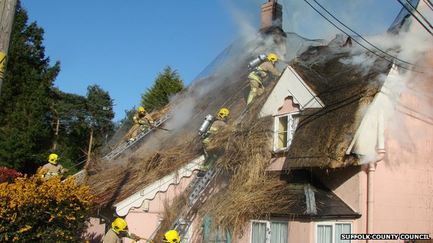 Firefighters on the roof of a cottage in Barham